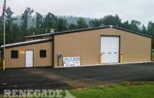 tan commercial steel building auto body shop