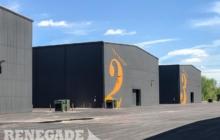 Gray steel metal building movie studio tall open clearspan