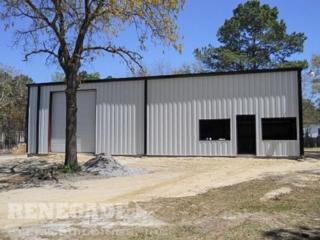 gray steel building with black trim, large roll up door, glass windows and door