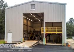 tan industrial steel metal building, large framed openings