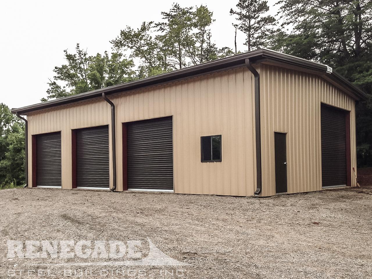 tan steel metal building with brown bronze trim, brown bronze rollup doors, brown gutters and downspouts, walk door and window
