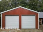 Red steel metal building with rollup doors