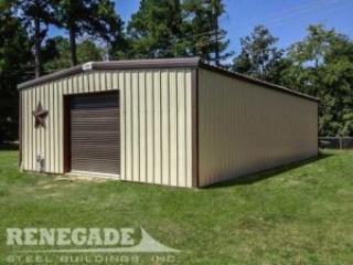 tan steel metal building with brown trim, rollup door