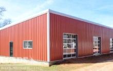 Red Steel Building with glass panel doors
