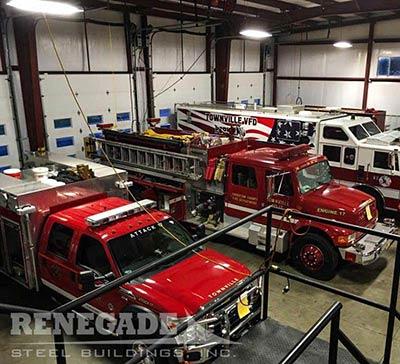 Steel Building fire station trucks parked inside