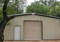 30x50x12 Renegade steel building with tan walls, brown trim, roll up door and walk door
