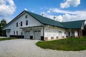 steel building barn look with portico, brick wainscot, canopies, barn doors,