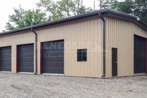 tan steel metal building with brown trim, rollup doors